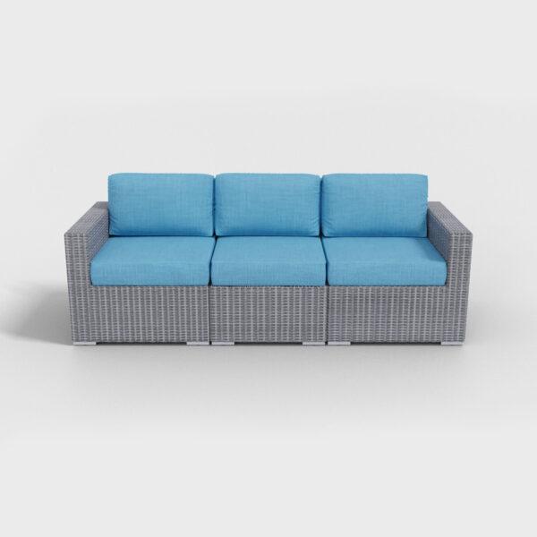 gray rattan sofa with aqua blue cushions