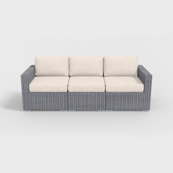 gray rattan sofa with beige cushions