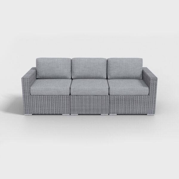 gray rattan sofa with light gray cushions